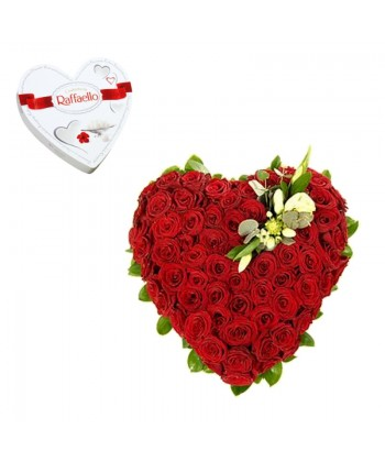 Inima florala din 69 trandafiri rosii si unul alb + inima Raffaello cadou